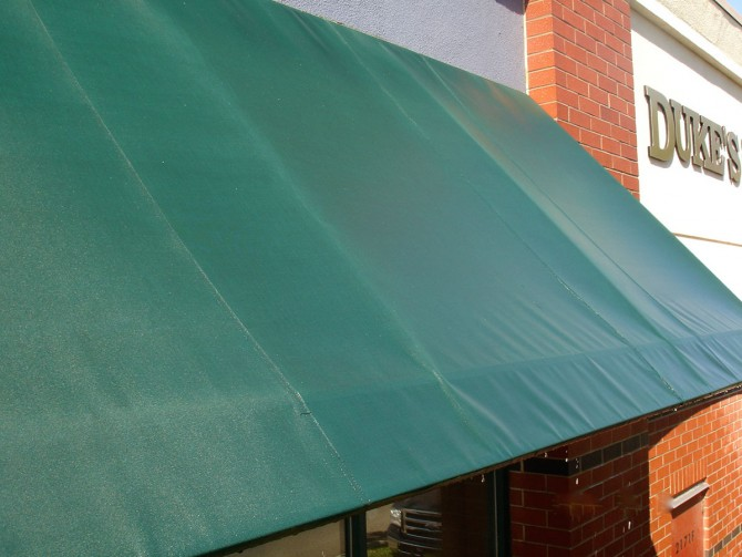 how to clean top of awning